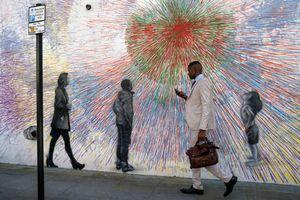 man walking mobile phone